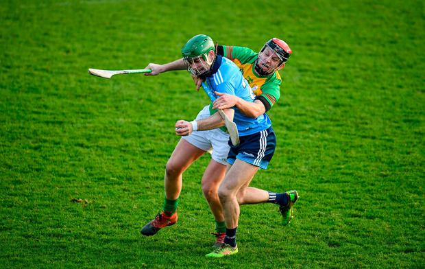 Cian Derwin of Dublin is stopped in his tracks by Carlow's Michael Malone. Photo: Sam Barnes/Sportsfile