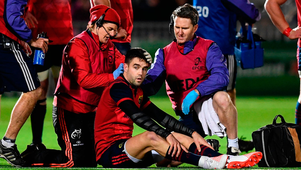 Conor Murray of Munster is treated for an injury during the European Rugby Champions Cup match against Glasgow Warriors. Photo: Sportsfile
