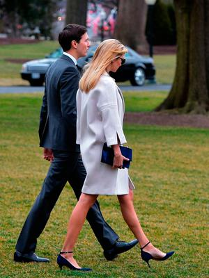 Jared Kushner (L), White House senior adviser, and his wife Ivanka Trump, make their way to board Marine One before departing from the White House on February 10, 2017, in Washington, DC. / AFP PHOTO / MANDEL NGANMANDEL NGAN/AFP/Getty Images
