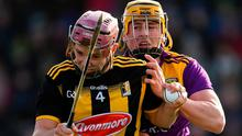 Kilkenny's Ciaran Wallace is tackled by Wexford's Damien Reck at Chadwicks Wexford Park. Photo: Ray McManus/Sportsfile