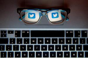 File photo dated 30/11/15 of the logo of social network site Twitter reflected in a pair of glasses as the social media giant has pledged to clamp down on trolls once and for all, according to reports. PRESS ASSOCIATION Photo. Issue date: Saturday December 26, 2015. Malicious users of the site are said to be hampering its efforts to be a frontrunner in the online news market and its European head, Bruce Daisley, told the Independent Twitter was committed to cleansing the service as it enters its 10th year. See PA story TECHNOLOGY Twitter. Photo credit should read: Dominic Lipinski/PA Wire