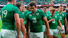 Dejected Ireland players, including Donnacha Ryan, Jared Payne, Ian Madigan and Robbie Henshaw, troop off the pitch after losing to England
