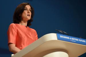 Secretary of State for Northern Ireland Theresa Villiers addresses the room during the Conservative Party annual conference 2014 at the ICC in Birmingham
