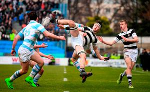 Ruadhan Byron of Belvedere College in action against Tom Maher of Blackrock College. Photo: Sportsfile
