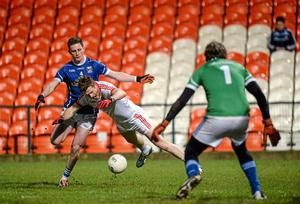 Tyrone's Niall McKenna goes to ground after a tackle from Joshua Hayes, Cavan