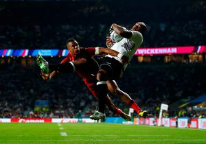 Nemani Nadolo of Fiji scores a try under pressure from Anthony Watson of England during the 2015 Rugby World Cup Pool A match between England and Fiji at Twickenham.  Photo by Mike Hewitt/Getty Images