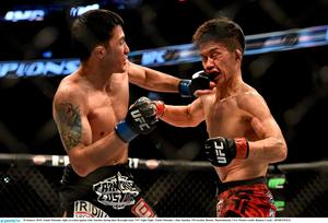 Tateki Matsuda, right, in action against Joby Sanchez during their flyweight bout. UFC Fight Night, Tateki Matsuda v Joby Sanchez, TD Garden, Boston