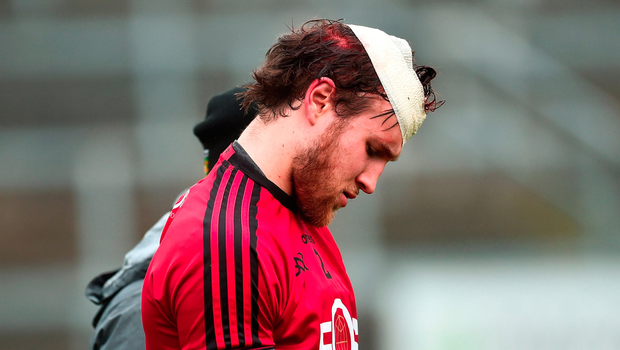 Down's Shay Murnin leaving the pitch after picking up a head injury in the warm-up. Photo by Oliver McVeigh/Sportsfile