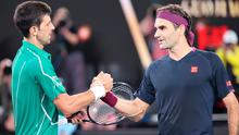 Serbia's Novak Djokovic (L) shakes hands with Switzerland's Roger Federer after his victory during their men's singles semi-final match on day eleven of the Australian Open tennis tournament in Melbourne on January 30, 2020. (Photo by DAVID GRAY/AFP via Getty Images)