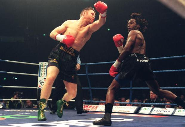 9 Nov 1996: Steve Collins of Ireland (left) swings and misses Nigel Benn, with a left hook, during the Benn v Collins rematch at the Nynex Arena in Manchester. Steve Collins won the fight after Nigel Benn's corner retired their man at the end of the sixth round. Mandatory Credit: John Gichigi/Allsport