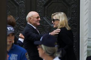 IAC/InterActiveCorp Chairman Barry Diller (L) greets journalist Diane Sawyer as they arrive to attend the funeral of comedienne Joan Rivers at Temple Emanu-El in New York September 7, 2014. REUTERS/Lucas Jackson