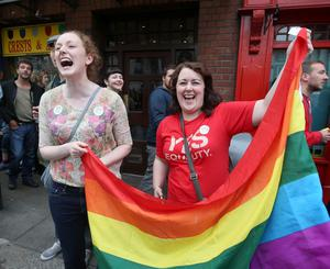 Deirdre Nally, left and Fiona Dullaghan celebrate the Yes Vote outside Dublin city hall on Dame Street in Dublin. Picture credit; Damien Eagers 23/5/2015