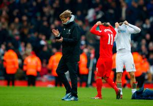 Liverpool manager Jurgen Klopp looks dejected as he applauds fans after the game