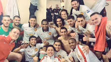 Manchester United players celebrate victory over Liverpool at Anfield