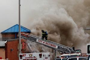 Firefigthers respond to a fire at a CVS pharmacy on Pennsylvania Avenue in Baltimore. Hundreds of rioters looted businesses and set buildings on fire in Baltimore on Monday in widespread violence that injured at least 15 police officers following the funeral of Freddie Gray, a 25-year-old black man who died after he was injured in police custody. Photo: Reuters