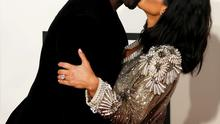 Rapper Kanye West and Kim Kardashian arrive at the 57th annual Grammy Awards in Los Angeles, California February 8, 2015.