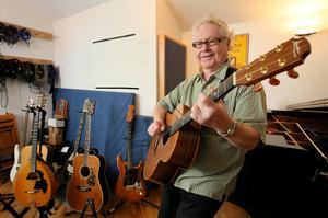 GUITAR PICKER: Paul Brady with a few of his favourite instruments in his home recording studio near Stepaside. Photo: Frank McGrath