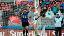 Pádraig McNulty, Tyrone, is shown a yellow card by referee Maurice Degan
