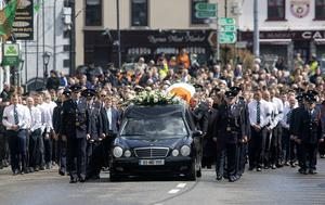 The cortege makes its way through Charlestown on the way to church pictured this afternoon at the funeral of Detective Garda Colm Horkan, at St. Jamses' Church, Charlestown, Co. Mayo. Photo: Colin Keegan, Collins Dublin