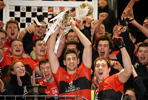 Paul Geaney, University College Cork holds aloft the Sigerson cup