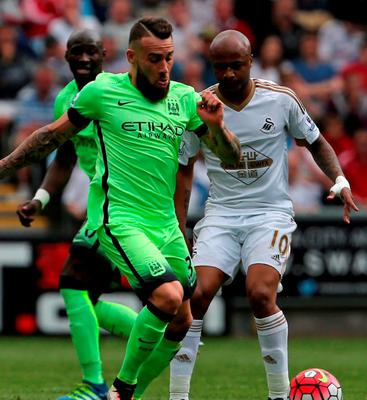 Manchester City's defender Nicolas Otamendi (L) vies with Swansea City's striker Andre Ayew.  Photo: Geoff Caddick/AFP/Getty Images