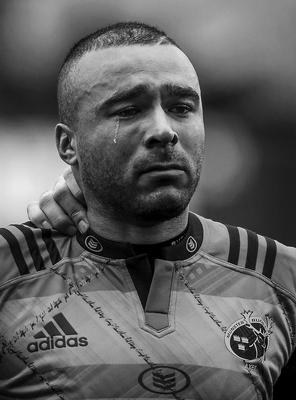 3rd SPORTS FEATURE  Munster's Simon Zebo sheds a tear during a minute's silence in memory of the late Munster head coach Anthony Foley before a match the day after his funeral Brendan Moran Sportsfile