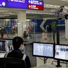 Airports have begun screening passengers arriving from Wuhan (Andy Wong/AP)