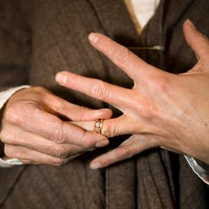 Close-up of woman removing ring