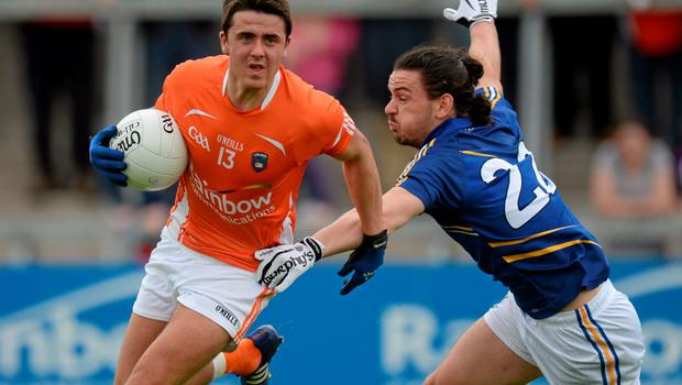27 June 2015; Stefan Campbell, Armagh, in action against Paul Cunningham, Wicklow. GAA Football All-Ireland Senior Championship, Round 1B, Armagh v Wicklow. Athletic Grounds, Armagh. Picture credit: Piaras Ó Mídheach / SPORTSFILE