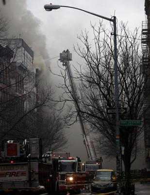 New York City Fire Department firefighters battle fire at a residential apartment building in New York City's East Village neighborhood. Reuters/Brendan McDermid