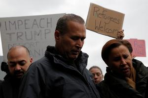 Iraqi immigrant Hameed Darwish stands with Congresswoman Nydia Velazquez (R) after being released at John F. Kennedy International Airport in Queens, New York, U.S., January 28, 2017.  REUTERS/Andrew Kelly