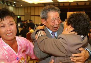 South Korean Min Ho-shik (centre), 84, reacts as he meets his North Korean younger sister Min Eun Shik, 81, during the separated family reunions at Mount Kumgang resort, North Korea. Photo: ReutersYonhap