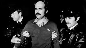 March 1984 following a shoot-out with Gardai  ... RUC members take custody of  Domnic McGlinchey was  was  handed over to the RUC by members of the Gardai at the border near  Carrickdale outside Dundalk.Pic Tom Burke      NPA/Independent collection