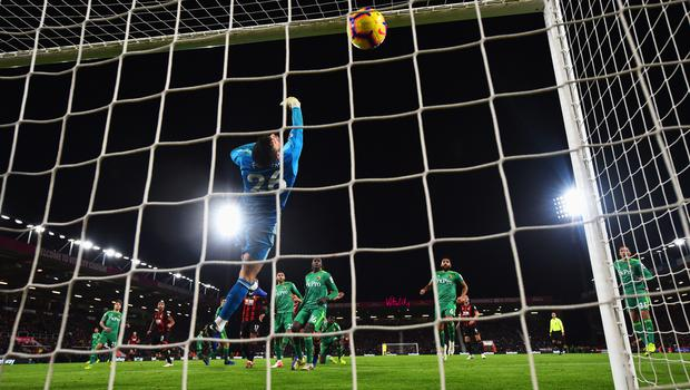Ben Foster of Watford fails to stop Callum Wilson of AFC Bournemouth (13) as he scores his team's second goal during the Premier League match against Watford (Photo by Dan Mullan/Getty Images)