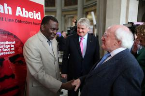 Biram Dah Abeid from Mauritania (left) the winner of the 2013 Front Line Defenders Award for Human Rights Defenders at Risk greets President Michael D Higgins (right) and Front Line Defenders Denis O'Brien (centre) in City Hall, Dublin