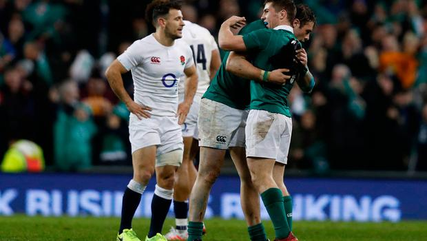 Players react at the final whistle in the Six Nations international rugby union match between Ireland and England at the Aviva Stadium in Dublin on March 18, 2017.   Ireland beat England 13-9 to deny the visitors a record-breaking Grand Slam victory in Dublin on Saturday. / AFP PHOTO / Adrian DENNISADRIAN DENNIS/AFP/Getty Images