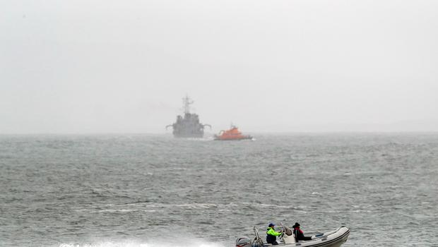An Irish naval vessel and other boats join the search for an Irish Coast Guard helicopter which went missing off the west coast of Ireland Photo: Brian Lawless/PA Wire