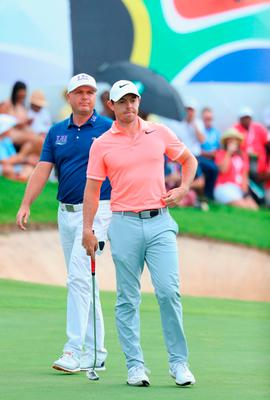 Rory McIlroy and Graeme Storm look on from the 18th green.  Photo by Warren Little/Getty Images