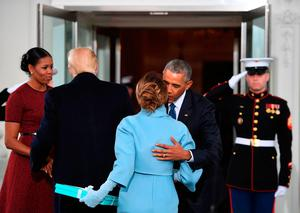 US President Barack Obama(R) and First Lady Michelle Obama(L) welcome Preisdent-elect Donald Trump(2nd-L) and his wife Melania(2nd-R) to the White House