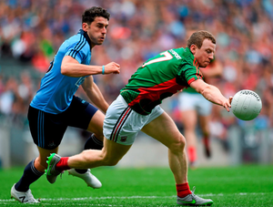 Mayo's Colm Boyle, here battling with Bernard Brogan (left), might be better suited to a man-marking job on Paul Flynn