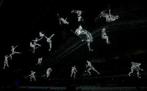 Lit figures are seen during the opening ceremony of the 2014 Sochi Winter Olympics