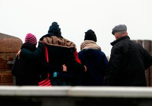 Family members gather at Blacksod Pier. Photo: Brian Lawless/PA Wire