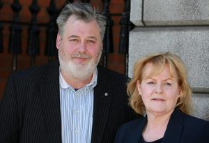 (Left) Derek Tynan, owner of a bodyshop and service centre at Damastown, Blanchardstown, Dublin pictured leaving the Four Courts  - with Mrs Mary Duffy