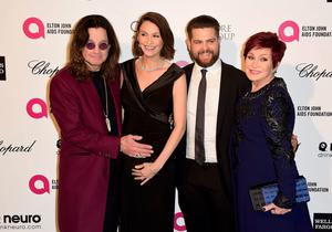 Ozzy Osbourne (L) embraces his daughter-in-law Lisa Stelly as he arrives with his son Jack and wife Sharon at the 2015 Elton John AIDS Foundation Oscar Party in West Hollywood