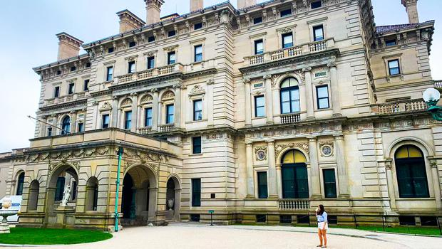 Caitlin McBride at the Breakers mansion in Newport, Rhode Island (for scale)