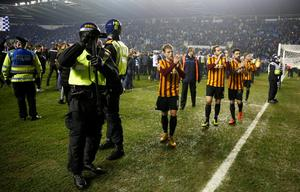 "Football - Reading v Bradford City - FA Cup Quarter Final Replay - The Madejski Stadium - 16/3/15 Bradford City's Billy Clarke applauds fans at the end as Reading fans invade the pitch and police look on Action Images via Reuters / Peter Cziborra Livepic EDITORIAL USE ONLY. No use with unauthorized audio, video, data, fixture lists, club/league logos or ""live"" services. Online in-match use limited to 45 images, no video emulation. No use in betting, games or single club/league/player publications.  Please contact your account representative for further details."