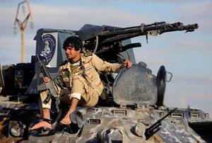 A Shi'ite fighter sits on a military vehicle in the town of Hamrin in Salahuddin province. Photo: REUTERS/Stringer