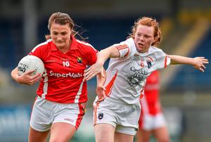 Cork's Annie Walsh gets away from the challenge of Niamh Marley of Armagh during the All-Ireland ladies football semi-final at Pearse Park. Photo: Paul Mohan / SPORTSFILE