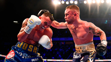 Carl Frampton (right) in action against Josh Warrington during their IBF World Featherweight title bout at the Manchester Arena. Photo by David Fitzgerald/Sportsfile