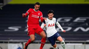 Joel Matip of Liverpool battles for possession with Son Heung-Min of Tottenham Hotspur